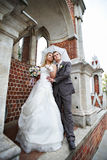Happy bride and groom in park royalty free stock photos