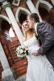 Happy bride and groom in park Stock Photos