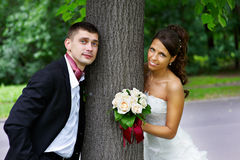 Happy bride and groom in park Royalty Free Stock Photography