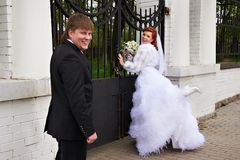 Happy Bride and groom in park Stock Images