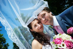 Happy bride and groom in park Stock Image