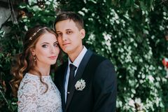 Happy bride and groom at a park on their wedding day royalty free stock photo
