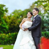 Happy bride and groom in a park. Wedding couple Royalty Free Stock Photos