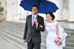 Happy bride and groom portrait outdoors Stock Photos