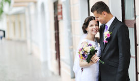 Happy bride and groom portrait outdoors Royalty Free Stock Photo