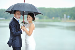 Happy bride and groom in a rainy wedding day Royalty Free Stock Images