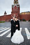 Happy bride and groom on Red Square near Kremlin Stock Image