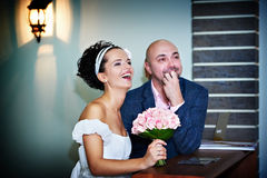 Happy bride and groom in rigistration of marriage Stock Photo