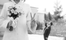 Happy bride, groom sad concept Royalty Free Stock Images