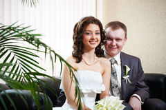 Happy bride and groom sitting together Royalty Free Stock Photography