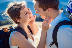 Happy bride and groom smiling closeup. Honeymoon in Alpine mountains Royalty Free Stock Photography