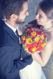 Happy bride and groom smiling to each other Royalty Free Stock Photography