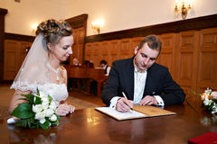 Happy bride and groom on solemn registration. Solemn registration of marriage in the Wedding Palace in Moscow Royalty Free Stock Photo