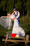 Happy bride and groom standing on the bridge Royalty Free Stock Images