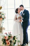Happy bride and groom in  studio Royalty Free Stock Photos