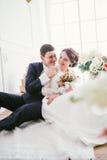 Happy bride and groom in  studio Royalty Free Stock Image