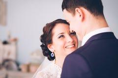 Happy bride and groom in  studio Stock Images