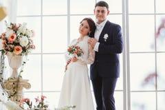 Happy bride and groom in  studio Stock Photo