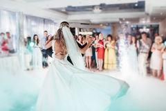 Happy bride and groom their first dance Stock Images