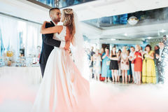 Happy bride and groom their first dance. Happy bride and groom and their first dance, wedding in the elegant restaurant with a wonderful light Royalty Free Stock Photo
