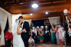 Happy bride and groom a their first dance, wedding Stock Photography