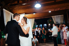 Happy bride and groom a their first dance, wedding. In the elegant restaurant with a wonderful light and atmosphere Royalty Free Stock Image