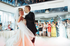 Happy bride and groom their first dance, wedding. Happy bride and groom and their first dance, wedding in the elegant restaurant with a wonderful light Royalty Free Stock Photography