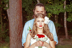 Happy bride and groom on their wedding. Beautiful newly-married couple outside Royalty Free Stock Photography