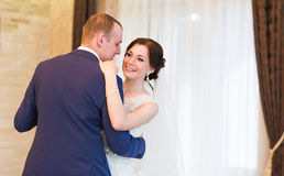 Happy bride and groom on their wedding indoor royalty free stock photography