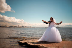 Happy bride and groom on their wedding near sea Royalty Free Stock Photos