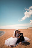 Happy bride and groom on their wedding near sea Royalty Free Stock Image