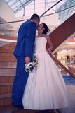 Happy bride and groom on their wedding stand on a wooden ladder Stock Photo