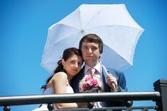 Happy bride and groom with umbrella Royalty Free Stock Images