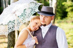 Happy bride and groom with umbrella Stock Photo
