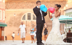 Happy bride and groom in Venice with balloons Royalty Free Stock Image