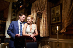 Happy bride and groom in vintage interior royalty free stock image