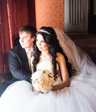 Happy bride and groom in vintage interior of resrourant Royalty Free Stock Photo