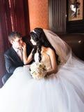 Happy bride and groom in vintage interior of resrourant Stock Photo