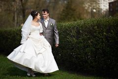 Happy bride and groom walking Royalty Free Stock Image
