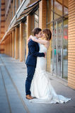 Happy bride and groom walking in a city Royalty Free Stock Image