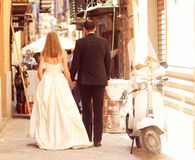 Happy bride and groom walking Stock Image