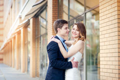 Happy bride and groom walking in the city at spring Royalty Free Stock Photo