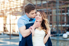 Happy bride and groom walking in the city at spring Stock Photo