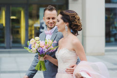 Happy bride and groom walking. Stock Photo