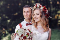 Happy bride and groom walking in spring day Royalty Free Stock Photos