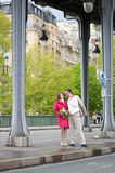 Happy bride and groom walking together Royalty Free Stock Photography