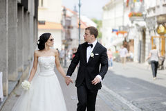 Bride and groom walking together Royalty Free Stock Images