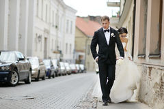 Bride and groom walking together Stock Photography