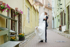 Bride and groom walking together royalty free stock image