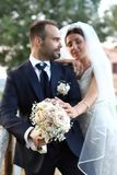 Happy bride and groom in wedding day. Wedding couple in love, newlyweds. Wedding concept. wedding bouquet in the foreground stock photos